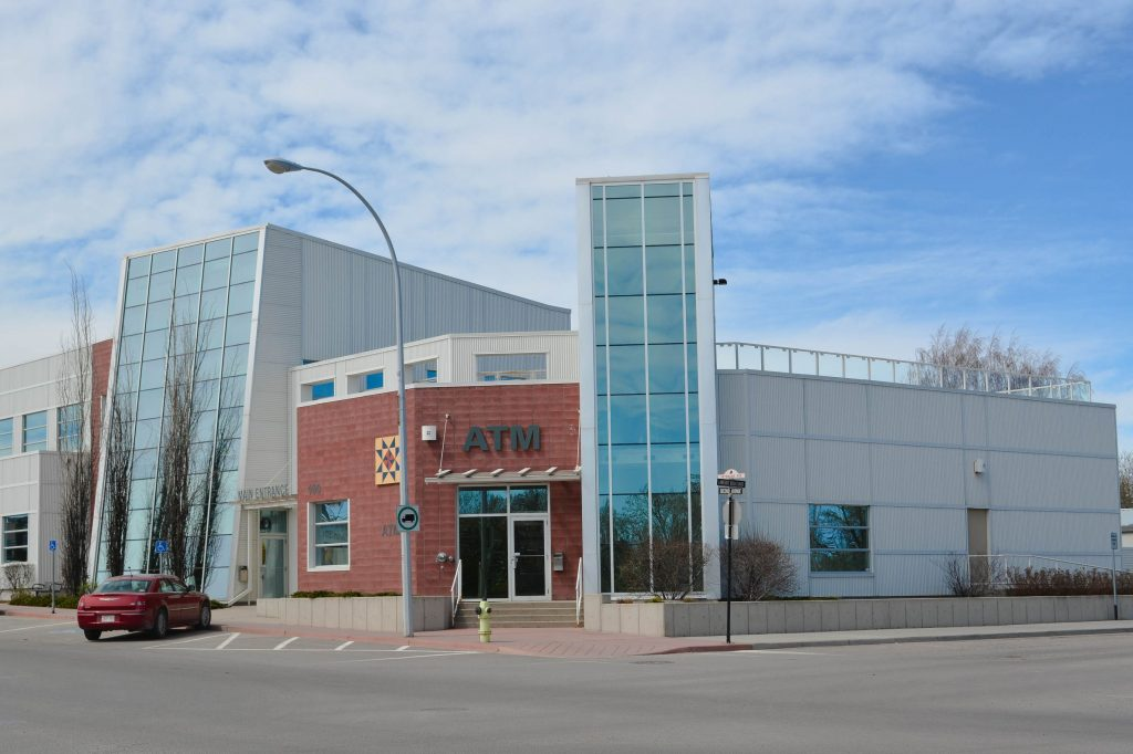<h3>Chinook Financial</h3> <p>Located in Strathmore, this LEED Certified credit union consisted of the demolition of the original Old King Edward Hotel, which involved selective abatement of hazardous material special procedures for erosion and sediment control. The new building consists of structural steel, masonry block, colored block veneer and metal siding, maximizing the utilization of regional materials and recycled content. This innovative building includes an ECO roof, low VOCs and a high efficiency energy management system.</p>